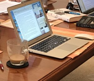 laptop with writing and coffee mug